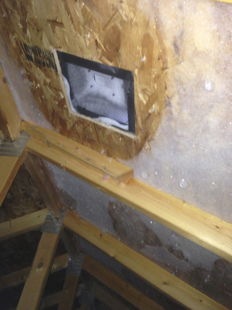 Attic frost near attic vent. Ventilation is not a solution for frost buildup.